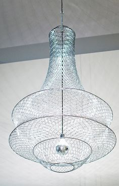 A chandelier made with... WAIT FOR IT!!... paper clips - how cool is that??