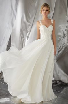 Courtesy of Morilee by Madeline Gardner Voyagé Collection; Wedding dress idea.