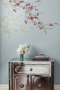 I like this table look a lot - I don't like mirrored furniture though, but similar idea with a dark grey/grey brown piece