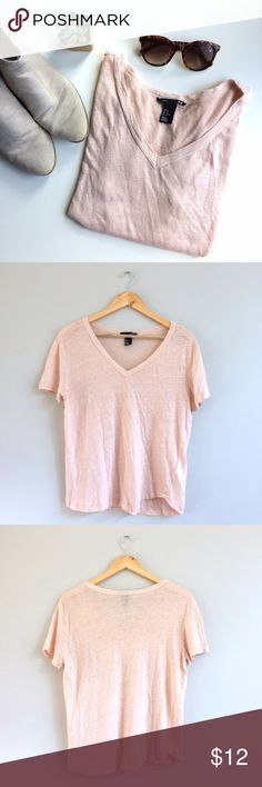 🎄SALE! H&M Blush Linen Tee Beautiful closet staple linen v-neck tshirt, in the perfect blush hue. Use it for layering this fall with boyfriend cardigans and blazers, and then pair with lighter skirts and jeans when the temps come back up in the spring! Bust: 19in, shoulder to hem: 22.5in, 100% linen. Gently worn, great condition. H&M Tops Tees - Short Sleeve