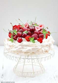 Cake with frosting of red fruits and whip cream