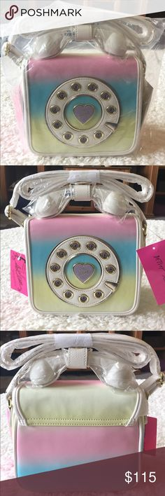 """NEW! BETSEY JOHNSON MINI PHONE CROSS BODY BAG BRAND NEW! BETSEY JOHNSON RAINBOW MINI PHONE CROSS BODY BAG WITH GOLDTONE HARDWARE & FLAP CLOSURE-Approximate Measurements are 8"""" H X 7"""" W X 3 1//2"""" D, with an adjustable strap....PLUG INTO COMPATIBLE CELL PHONE TO USE PHONE RECEIVER TO TALK THROUGH-SEE PICK FOR COMPATIBILITY....TESTED & IT WORKS!! Betsey Johnson Bags Crossbody Bags"""