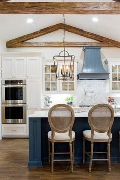Kitchen island and vent hood (and sliding door for pantry)