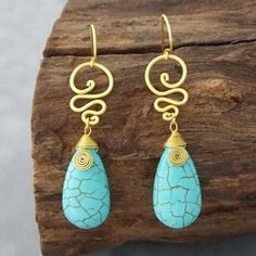 @Overstock - A pleasant addition to any outfit, there earrings are embellished with reconstructed turquoise gemstones. These brass earring were handmade in Thailand by artisan, Siam.  http://www.overstock.com/Worldstock-Fair-Trade/Brass-Cute-Turquoise-Teardrop-Swirl-Earrings-Thailand/6128163/product.html?CID=214117 $17.99