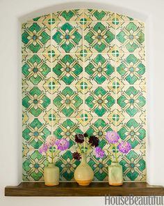 reclaimed Spanish tile transforms a bland alcove in the entry into a more authentic focal point and the perfect backdrop for handmade ceramic vases.