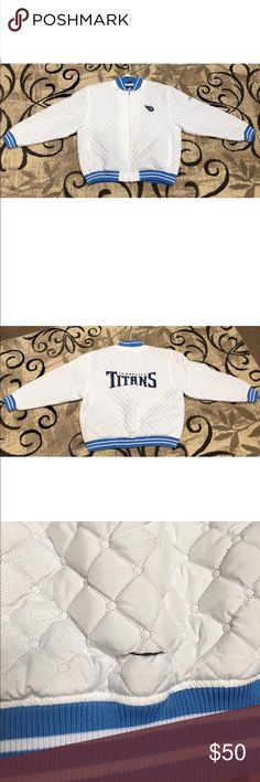 Tennessee Titans Coat Up for sale is a Tennessee Titans quilted womens coat. This does not have tags. This is NOT a thick coat. There is a 1.500'cut on the bottom back of the coat. The cut does not go all the way through to the inside. Comeswith a snap on hood.  Size: XXL  Measurements:   armpit to armpit 28.125'  armpit to bottom of coat 15.00'  armpit to end of sleeve 18.250'  shoulder to end of sleeve 26.00'  shoulder to bottom of coat 27.500'  bottom of neck to bottom of coat 25.675'…