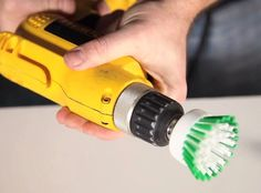 Adding the head of an ordinary plastic scrub brush to a power drill can add muscle to your cleaning. It may also make cleaning fun.