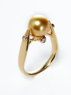 Golden Pearl & Diamond Ring by Tara Pearls on Gilt  $1,028 (2,055 otherwise)  Golden south sea cultured pearl and 14K yellow gold ring with diamond accents        Total diamond carat weight is 0.08      Diamond color is G-H      Diamond clarity is SI      0.4 inches long