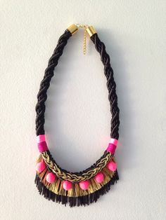 Handmade rope necklace with brass clasp, fringing and plaited detailing. Sits just above the bust.