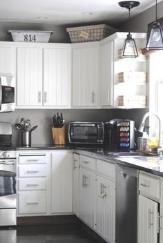 10 Ways to Update Your Kitchen on a Dime....like the baskets on top of cabinets. Good way to use the wire baskets I love but have no use for.