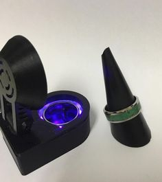 Model T ring box. A light up ring box that can charge glow rings.