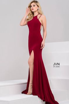 Sexy floor length form fitting burgundy jersey prom dress with high slit features sleeveless bodice with high neckline and open back.