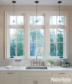 Windows, pendants, deck mount faucet  good lines - mix of trad and clean