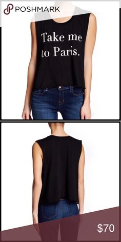 """Wildfox Paris Tank Everyone wants to go to Paris right??  Wildfox ribbed crewneck tank with curved hem and side vents. 100% cotton.  Measurements laid flat: bust 24"""" and length from top of shoulder to hem 21"""". Wildfox Tops Muscle Tees"""