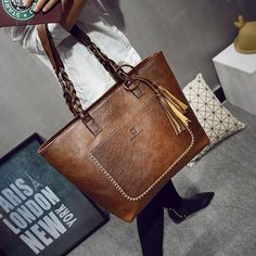 Find More Top Handle Bags Information about 2017 Large Capacity Women Bags Shoulder Tote Bags bolsos New Women Messenger Bags With Tassel Famous Designers Leather Handbags High Quality bag with tassels China bags with Suppliers Cheap designer tote bag Fashion Handbags, Fashion Bags, Style Fashion, Fashion Jewelry, Hipster Fashion, Fashion Trends, Bags Travel, Designer Leather Handbags, Luxury Handbags