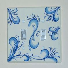Hand painted double switch plate pottery.