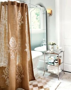 Love shower curtain. Gold accents in bathroom