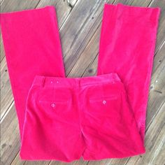 Red cotton Express pants Red cotton pants that feel like velvet. The photo makes them look a little brighter than they am really are. Flare leg. In excellent condition. 98% cotton, 2% spandex. 32 inch inseam. Thanks for looking. Express Pants Boot Cut & Flare