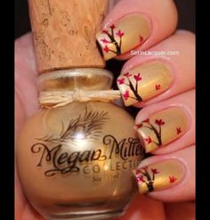 Megan Miller Champagne base color. Then using a nail art brush I applied Megan Miller Ganache for the tree branches and Framboise for the leaves. Don't worry about making the leaves and branches perfect. Even in nature each leaf and branch has imperfections.