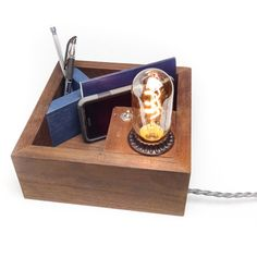 This handmade wooden Desktop Organizer + Edison Lamp was designed to be be an attractive solution to your desk clutter. The style is rustic modern, made from naturally chocolate brown Tropical Walnut wood (not stained), and with a painted blue org.