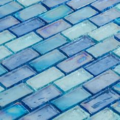 Iridescent Glass Mosaic Tile Pale Blue Blend 1x2 for pool, Jacuzzi, water feature, spa, backsplash, bath, and fireplace. Watch video for color, size and finish details.