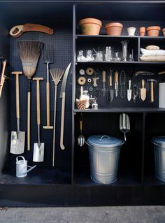 A New Use for Chalkboard Paint: Toolshed Makeover, Garden Edition Michelle created her tiny, garden shed by co-opting space from her garage behind her Mill Valley, California, home. (See Steal This Look: My Mini Garden Shed in a Garage for mor Garage Shed, Garage House, Garage Doors, Garage Walls, Garage Workshop, Shed Conversion Ideas, Garden Shed Interiors, Shed Makeover, Makeover Tips