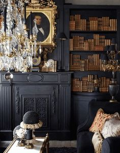 Flat black walls and shelving with gold and leather book spines, ornate gold picture frame... dramatic and opulent. *swoon*
