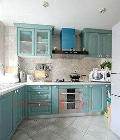 White Concrete Countertops, Concrete Tiles, Teal Cabinets, Stainless Steel Kitchen Cabinets, L Shaped Kitchen, Yellow Walls, Creative Home, Small Apartments, New Homes