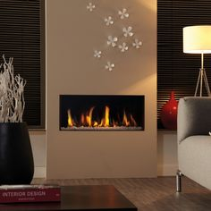 The Dru Metro 80X: It has a unique burner, which spreads the fire across the entire width and depth of the fire bed, while the extra tall glass window provides a much higher flame picture than that of ordinary gas fires.  #kernowfires #wadebridge #redruth #cornwall #dru #gas #fire #modern #contemporary #inset #home #living #room #glass #window