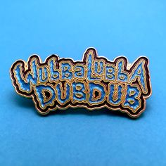 Wubba Lubba Dub Dub pin from Rick and Morty. These enamel pins glow in the dark and have all-over glitter. Available in blue or blue/orange.