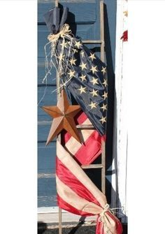 Adorned with a tea-stained Americana flag and accented with a rusty star, this ladder will be a great addition to any Americana home decor or any front porch. This American Flag ladder measures approx
