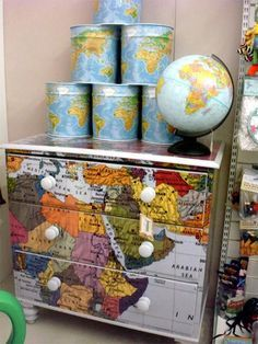 I love this idea: decoupage a map onto furniture!----I should not have looked at decoupage....