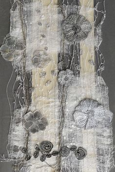 Textile art on vintage fragment by Kirstine Higgins.                                                                                                                                                      More