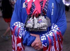 A volunteer holds the marathon finisher medals at the Annual Detroit Free Press/Talmer Bank Marathon in Detroit. Detroit Free Press, Marathon, Photography, Ing Marathon, Photograph, Marathons, Photo Shoot, Fotografia, Fotografie