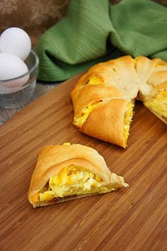 bacon, egg, and cheese in a crescent roll. Would love to have this for breakfast, like, all the time!