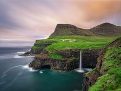 19. Journey to the edge of a cliff in the Faroe Islands to visit the remote village of Gásadalur and enjoy breathtaking views.