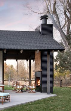 Riverside Modern Farmhouse Tour Modern Farmhouse Outdoor Fireplace steel fireplace with black corrug Farmhouse Outdoor Fireplaces, Modern Outdoor Fireplace, Metal Fireplace, Outdoor Fireplace Designs, Fireplace Ideas, Outdoor Rooms, Outdoor Gardens, Outdoor Living, Outdoor Decor