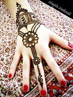 Henna ~ Mendhi except up the ring finger not the middle finger.