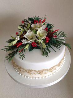 Christmas Cake with wired sugar flower spray. www.designer-cakes.co.uk Lancashire