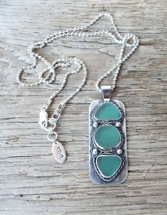 This sea glass necklace by SunshineDayDesigns is reversible & includes genuine  sea glass from Puerto Rico #seaglass #necklace #weddingjewelry