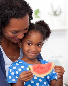 Portrait of a smiling girl eating fruit ...  african, afro-american, apple, beautiful, beverage, boy, bread, breakfast, cereal, cereals, coffee, cute, day, diet, drink, eat, egg, family, female, flakes, food, freshness, fruit, fun, girl, glass, guy, having, healthcare, healthy, juice, kitchen, liifestyle, love, meal, morning, mother, nutrition, orange, people, portrait, room, smile, table, tea, together, up, vegetables, watermelon, woman