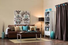 To achieve a down-to-earth contemporary casual style, choose a warm, cozy color palette—like deep browns and pops of turquoise. Living Room Turquoise, Teal Living Rooms, Living Room Colors, New Living Room, Living Room Designs, Brown Couch Living Room, Brown Couch Decor, Dark Brown Couch, Living Room Inspiration