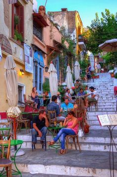 sipping coffee on the stairs of the picturesque neighbourhood of Plaka, Athens, Greece