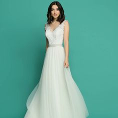 Flow down the aisle in this soft tulle gown perfect for your destination or beach wedding!