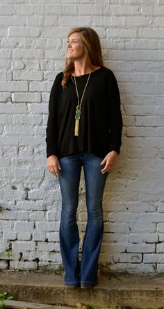 Simple black sweater, flared jeans, long necklace. Simple but sophisticated fall fashion. -Studio 3:19