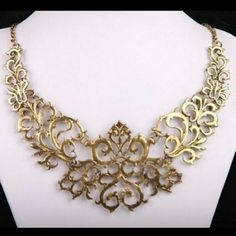 GOLDEN HOLLOW PATTERN BIB STATEMENT NECKLACE A new golden metal hollow out pattern bib statement necklace. Jewelry Necklaces