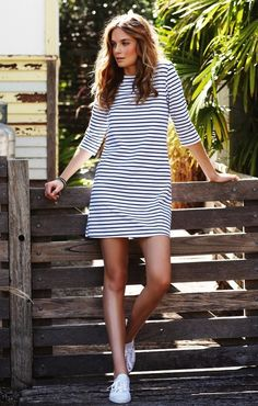 LOVE THIS!   A simple T-shirt dress in a fine graphic stripe with spanking-new sneakers.