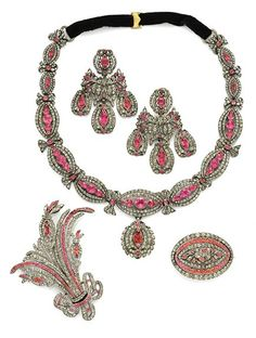 Georgian Paste Parure, circa 1760  Comprising a necklace of 11 navette-shaped open work links, a pair of ear pendants, and two brooches — one of oval design the other as an aigrette spray.  In fitted case by A La Vielle Russie. From the collection of Malinda Menotti, daughter of Happy Rockefeller.