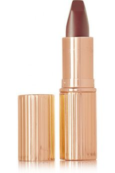 """""""Create the illusion of fuller, wider lips"""", reveals makeup guru Charlotte Tilbury about her new Matte Revolution lipstick range. The Bond Girl hue is our pick for a smooth seductive finish. #NETABeauty NET-A-PORTER"""
