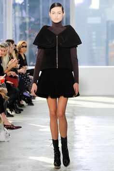 6b. Delpozo  Fall 2014 Ready-to-Wear Collection The blouse with gold zipper closure has a subtle interpretation of the neckline on a princess dress that was popular during the crinoline time period.